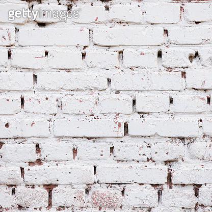 Closeup of vintage white brick wall texture. Old stonewall wallpaper. Purified, painted, brick wall with a textured background. Abstract Web Banner. Copy space