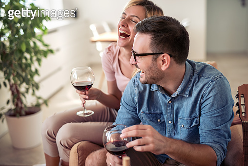 Couple drinking red wine at home