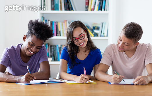 African american male student with nerdy students
