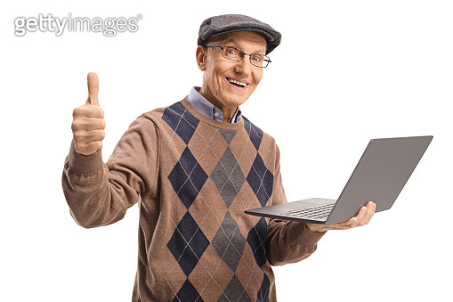Elderly man holding a laptop computer and showing thumbs up