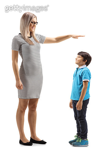 Woman gesturing with hand and showing the height of a young boy