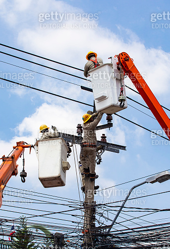 The electrical worker are repairing the electrical system