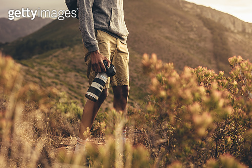 Photographer hiking in nature