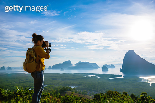 Female tourist photographers travel on the mountain. Landscape Beautiful Mountain on sea at Samet Nangshe Viewpoint. Phang Nga Bay ,Travel adventure, Travel Thailand, Tourist on summer holiday vacation.