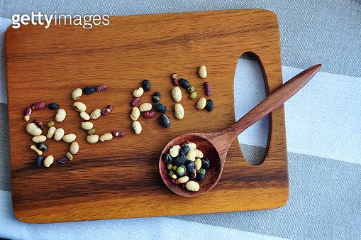 Varieties Beans Shape in Wording Bean on Wooden Board