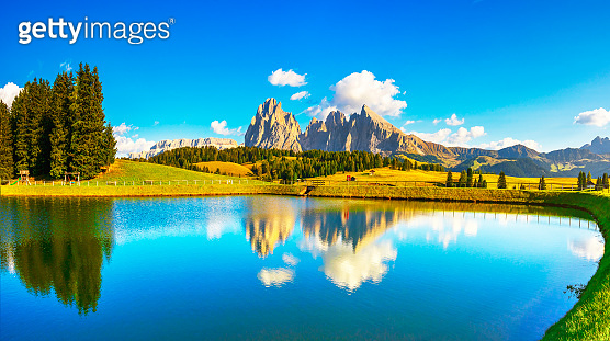 Lake and mountains, Alpe di Siusi or Seiser Alm, Dolomites Alps, Italy.