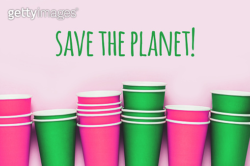 Plastick cups background. Living coral concept of environment pollution.