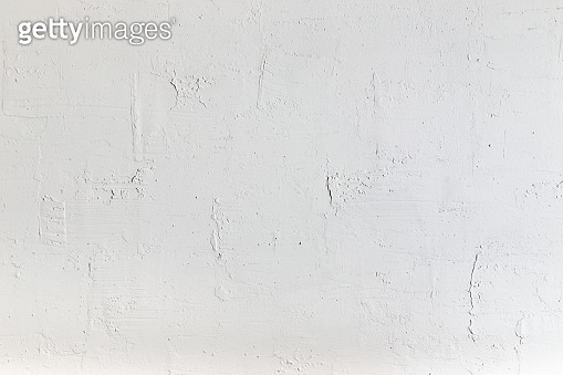 Rough decorative concrete wall background texture.