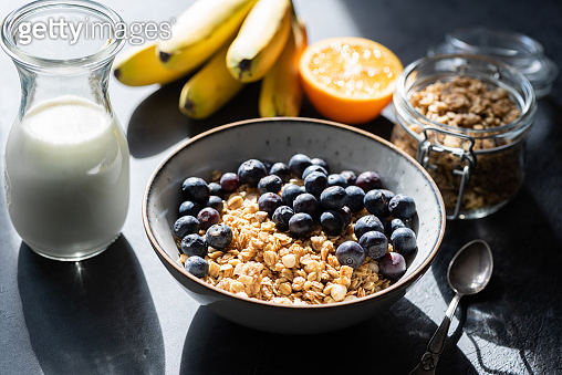 Tasty Granola And Blueberries In Bowl