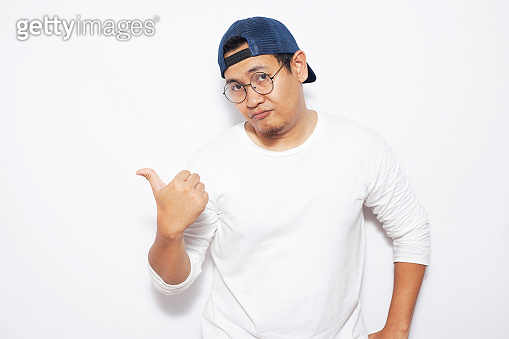 Young Man Showing and Pointing Something on His Side