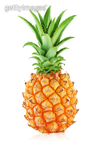 One whole pineapple with leaves isolated on white