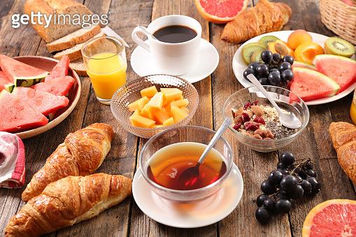 healthy breakfast with coffee, tea, bread, muesli and fruits