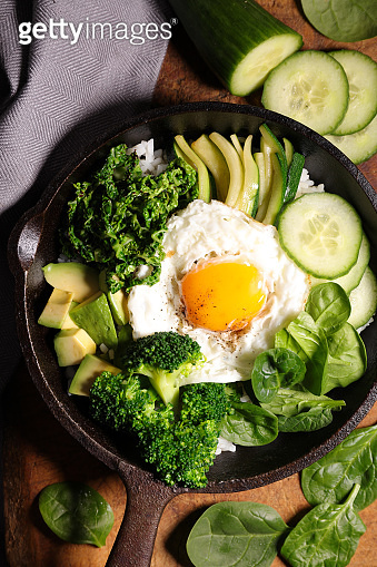 fried egg with greeen vegetable