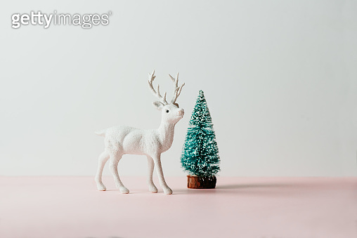 reindeer toy and pine tree, holiday composition