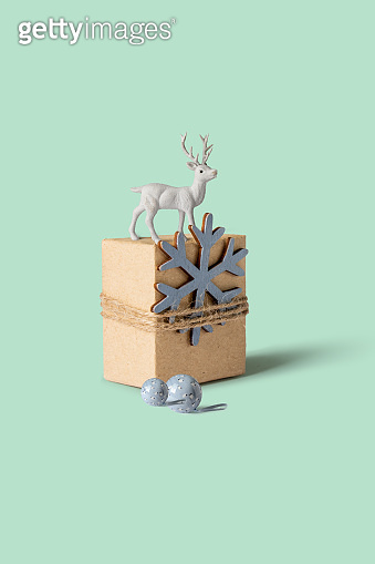 Christmas gift box with snow star and white reindeer