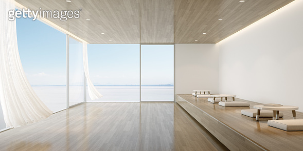 Perspective of modern luxury living room with timber seating area and small table on sea view background,Waiting area of cafe with the wind and flowing curtain. 3D rendering.