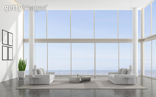 Architecture of white double space living room ,minimal style with twin sofa and furniture on laminate floor .Interior design with high glass panel on sea view background. 3d rendering.