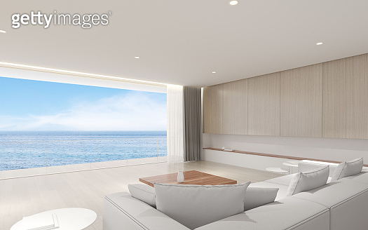 Perspective of modern luxury living room with white sofa on sea view background,Idea of family vacation - warm interior design - 3D rendering.