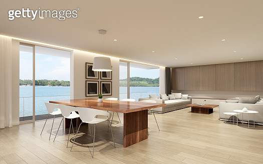 Perspective of modern luxury living room with wood dining table and white sofa on sea view background,Idea of family vacation - warm interior design - 3D rendering.
