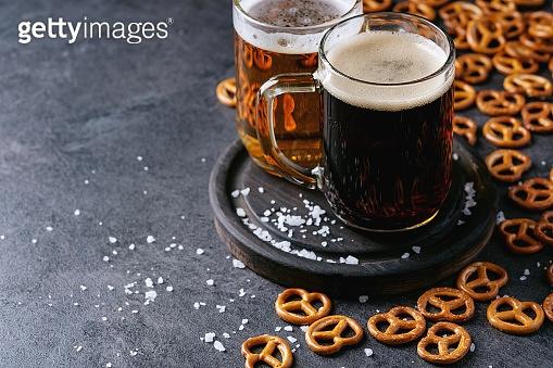 Light and dark craft beer in glass mugs