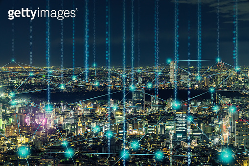 Digital Composite Image Of Illuminated Cityscape With Binary Numbers At Night