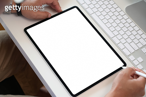 Businessman using digital tablet mock up blank screen display