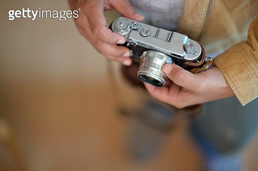 Photographer man holding vintage retro camera