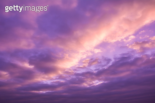 Beautiful nature background. Purple sky with clouds