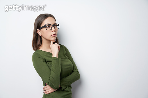 Profile of Confident woman in glasses looking to side