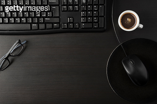Black desk with coffee