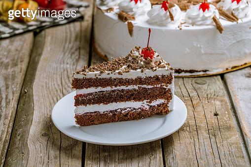 black forest cake on wooden background