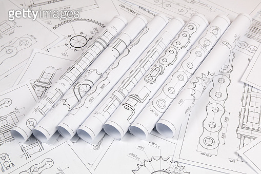 Technical engineering drawing, details of drive industrial chain, sprocket and mechanisms. Mechanical engineering, technology of metal processing.Engineer working.