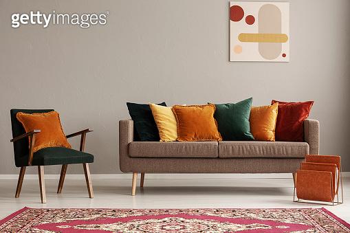 Rustic carpet on the floor of fashionable retro living room interior