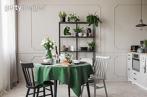 Breakfast on table in stylish grey kitchen in elegant apartment
