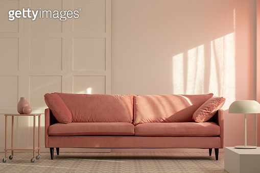 Pastel pink couch in white living room interior, copy space on empty wall