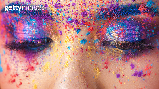 explosion of color, multi-colored shadows scattered on the eyelids. Colored Smokey eyes and blue eyebrows.