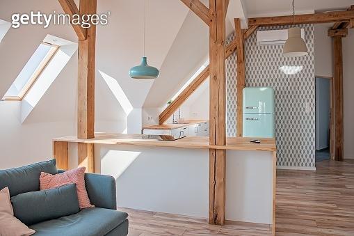 Bright attic kitchen in apartment.