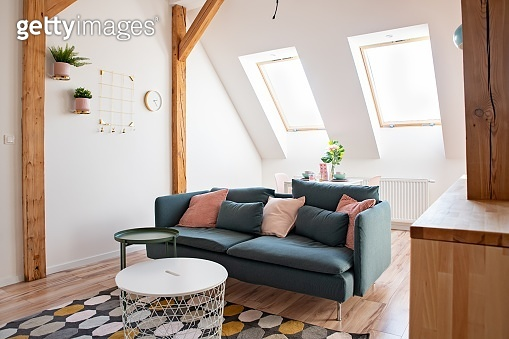 Modern bright living room with textile sofa