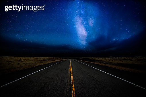 Dramatic night sky over a highway