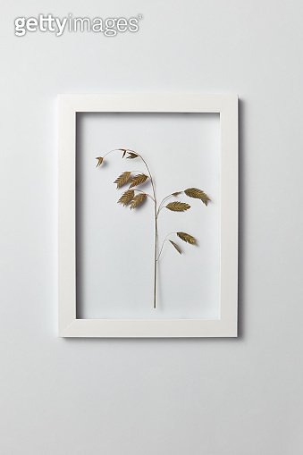 Floral frame with natural organic leaf on a light background.