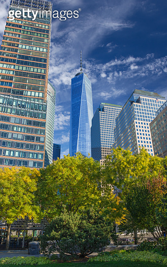 Battery Park in Autumn Colors with World Trade Center Tower and High-rises of World Financial Center in Background, Manhattan Lower West Side, NY, USA