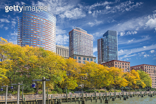 Battery Park in Autumn Colors with Residential High-Rises in Background, Manhattan Lower West Side, NY, USA