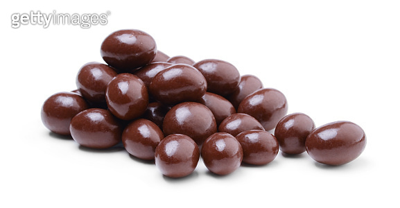 Peanuts covered in chocolate isolated on white