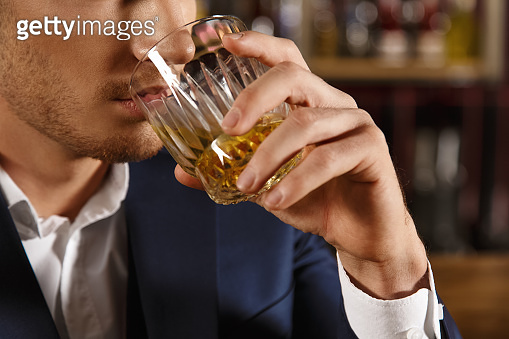 Handsome man relaxing at the bar