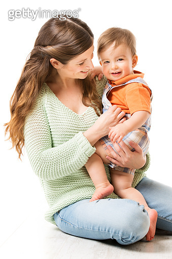 Mother and Baby, Happy Mom with Child one year old sitting on floor, Family on White