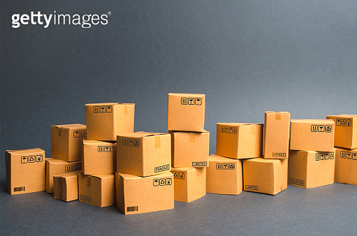 Many cardboard boxes. products, goods, Warehouse, stock. commerce and retail. E-commerce, sale of goods through online trading platform. Freight shipping, deliver. sales of goods and services.