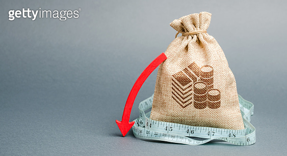 Money bag with red arrow down. The concept of reducing profits. Unprofitable business. Capital outflow. Report and financial performance. Limited budget. Low income and salary. Drop, fall. Recession