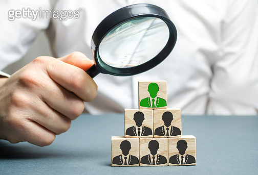 Find a talented employee. Businessman searching for new employees. Staff recruitment. Select a person in the team. Attracting people to work. Human Resource Management. Recruiting. Magnifying glass