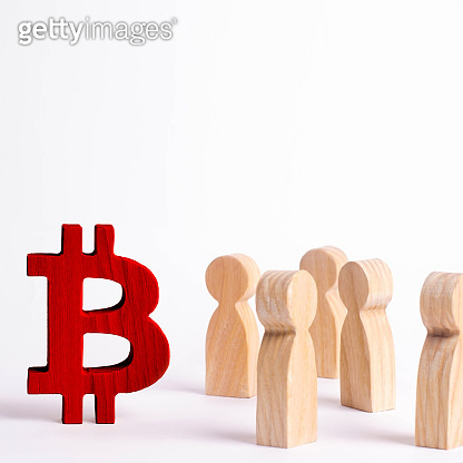 Wooden figures of people are standing near a bitcoin on a white background. Crypto currency, blockchain technology. The collapse and rise cost of bitcoin. Mining farms, miners, stock exchange crypts.