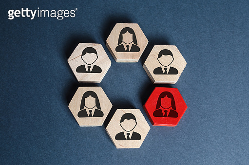 Hexagons with business employees in an organized structure. A red figure means a leader or employee is a weak link, toxic and incompetent. Spy. Business management and teamwork. Organization